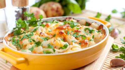 Spring veggie casserole with little herb dumplings