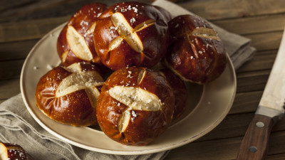 Caramelized Onion Pretzel Rolls with Caraway Salt