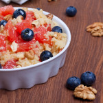 Sweet couscous with honey, pink grapefruit and blueberries