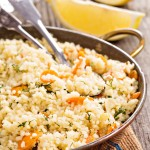 Couscous with vegetables and lemon in a pan
