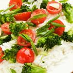 Jasmine rice with cherry tomatoes and broccoli. Shallow dof.