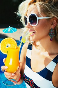 Beautiful, young girl with a summer cocktail.